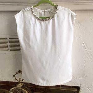 White blouse with beading around neckline